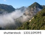 cloudy mountains china   Shutterstock . vector #1331109395