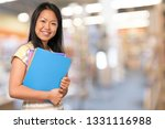 young woman holding books | Shutterstock . vector #1331116988