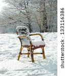 Wicker Chair On A Snowy Meadow...