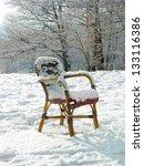 Wicker Chair On A Snowy Meadow...
