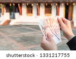 Cropped shot view of someone holding banknotes of Laos kip money (50,000 kip) the national currency of Laos.