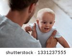 dad about to carry baby boy ... | Shutterstock . vector #1331237555