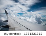 plane wing in sky | Shutterstock . vector #1331321312