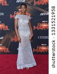 Small photo of LOS ANGELES - MAR 04: Lashana Lynch arrives for the 'Captain Marvel' World Premiere on March 04, 2019 in Hollywood, CA