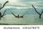 man lying relaxed and happy in... | Shutterstock . vector #1331678375