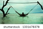 man lying relaxed and happy in... | Shutterstock . vector #1331678378