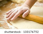 hand with rolling pin and flour | Shutterstock . vector #133176752