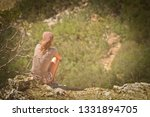 girl travels in the mountains... | Shutterstock . vector #1331894705