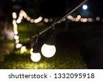 outdoor string light bokeh... | Shutterstock . vector #1332095918