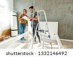 couple assembling furniture in...   Shutterstock . vector #1332146492