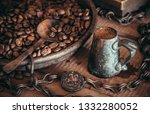Offee In A Brass Cup Near A...