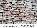 gabion bulk fence with stones... | Shutterstock . vector #1332355142