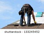 roofer laying down asphalt roof ... | Shutterstock . vector #133245452
