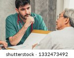 male doctor team talking to...   Shutterstock . vector #1332473492