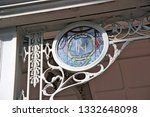 Small photo of Singapore February 2017. Wrought iron decorative panel with circular leaded glass insert with intertwined letter RH thereon. Supported in wrought iron frame around door if the Raffles Hotel
