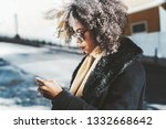 a curly hair african american... | Shutterstock . vector #1332668642