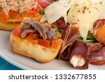 fresh appetisers table with... | Shutterstock . vector #1332677855