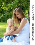 mother and child enjoying nature | Shutterstock . vector #133277798
