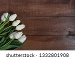bunch of white tulips on brown... | Shutterstock . vector #1332801908