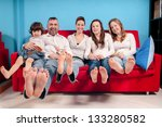happy family on the couch in...   Shutterstock . vector #133280582
