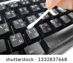 Cleaning Keyboard With Cotton...