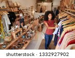 customers browsing in... | Shutterstock . vector #1332927902