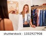 sales assistant serving female... | Shutterstock . vector #1332927908