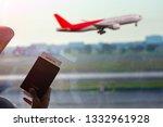 woman holding passport and... | Shutterstock . vector #1332961928