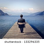 Young Businessman Sitting On A...