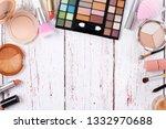 female beauty items on wooden... | Shutterstock . vector #1332970688