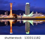 Kobe, Japan skyline with puddle reflections - stock photo