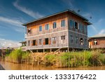 A House On Bamboo Sticks In...