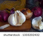garlic  red onions and a yellow ... | Shutterstock . vector #1333202432