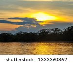 colorful sunset over cuyabeno... | Shutterstock . vector #1333360862