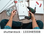 close up man's hands with tools ... | Shutterstock . vector #1333485008