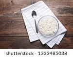 oatmeal with spoon on white... | Shutterstock . vector #1333485038