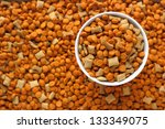 Stock photo pet food in the dog dish with background of pet food out focus 133349075