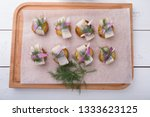 salted raw herring with potato... | Shutterstock . vector #1333623125