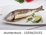 grilled dorado fish served on a ... | Shutterstock . vector #1333623152