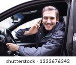 closeup.smiling man talking on... | Shutterstock . vector #1333676342