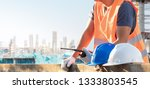 male laborers are working in...   Shutterstock . vector #1333803545