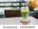 iced matcha green tea latte. | Shutterstock . vector #1334028692
