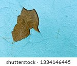 wall with cracked and fallen off blue paint stock photo