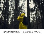 man in a yellow raincoat with a ... | Shutterstock . vector #1334177978