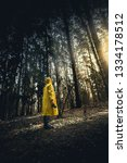 man in a yellow raincoat with a ... | Shutterstock . vector #1334178512