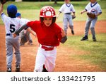 Youth Baseball Boy Running...