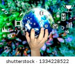 hand holding touch earth and... | Shutterstock . vector #1334228522