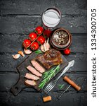 grilled beef steak with... | Shutterstock . vector #1334300705