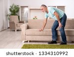 white bearded old man suffering ... | Shutterstock . vector #1334310992