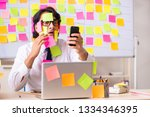 young employee in conflicting... | Shutterstock . vector #1334346395